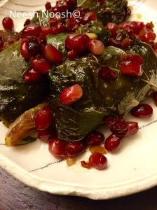 Shmot: stuffed grape leaves with pomegranates
