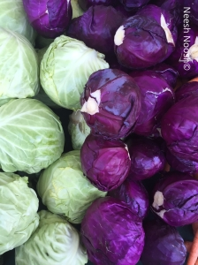 Green and purple cabbages. La Cienega Farmers Market